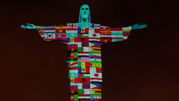 Brazil's Christ the Redeemer lit up with flags of countries battling coronavirus